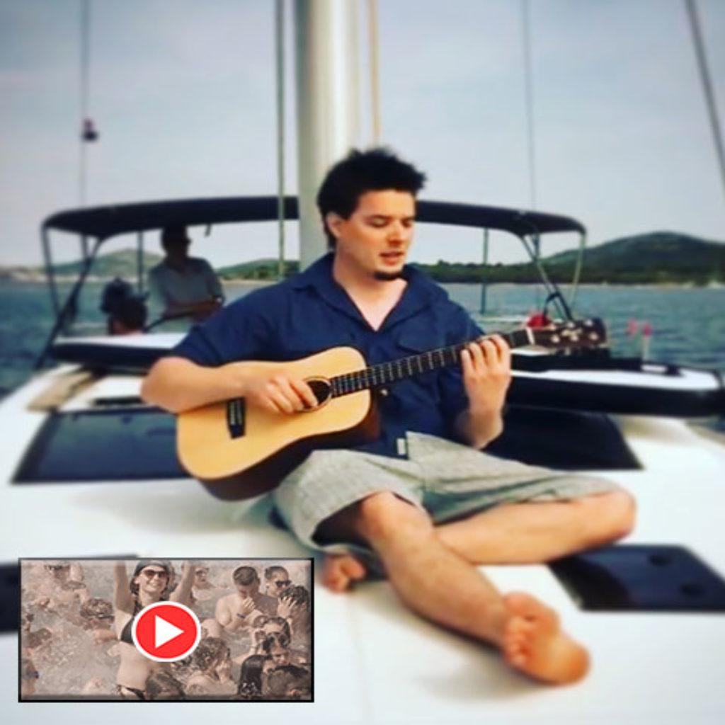 music video rewarding screenshot Emanuel Grand on sailing boat